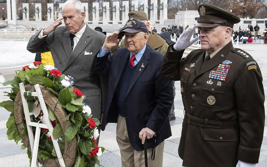 Friends of the National World War II Memorial Chairman Josiah Bunting III, Iwo Jima battle veteran Ira Rigger and Joint Chiefs of Staff Chairman Gen. Mark Milley salute during a wreath laying at a 75th anniversary ceremony, Feb. 19, 2020 at the National World War II Memorial in Washington, D.C.