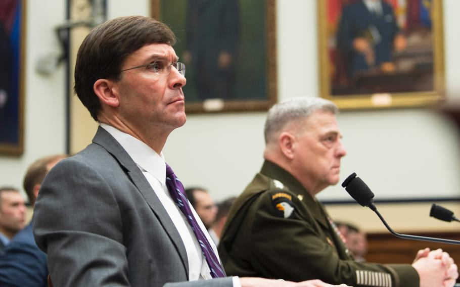 Defense Secretary Mark Esper and Chairman of the Joint Chiefs of Staff Gen. Mark Milley listen to a question during a House Armed Services Committee hearing on Capitol Hill in Washington on Wednesday, Feb. 26, 2020.