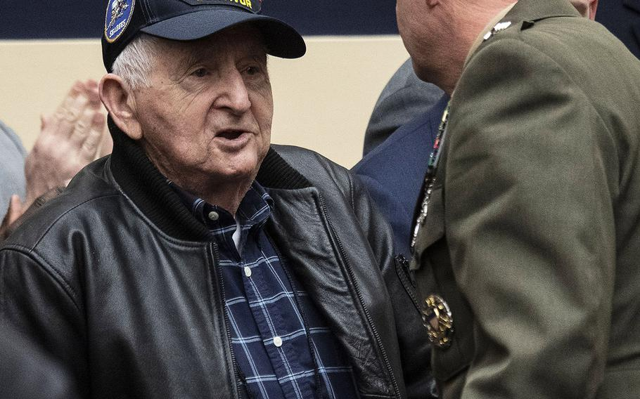 Former Navy Petty Officer 2nd Class Clinton Trefethen, 98, an Iwo Jima battle veteran, shakes hands with U.S. Marine Corps Commandant Gen. David H. Berger after being introduced at a House Armed Services Committee hearing on Capitol Hill, Feb. 27, 2020.