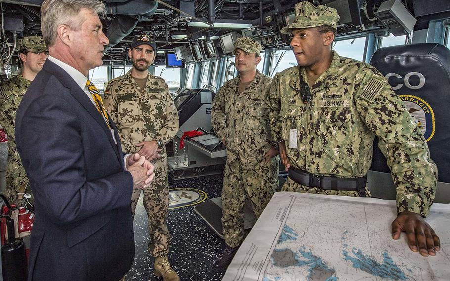 U.S. Ambassador to Norway Kenneth J. Braithwaite speaks with sailors in the pilothouse of the guided-missile destroyer USS Farragut during a tour of the ship in May, 2018.