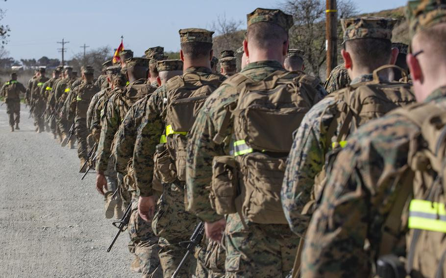 U.S. Marines with Headquarters Company, 13th Marine Expeditionary Unit, I Marine Expeditionary Force, conduct a conditioning hike for pre-deployment training at Marine Corps Base Camp Pendleton, Calif., Jan. 30, 2019.