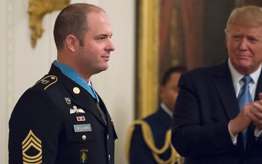 Master Sgt. Matthew Williams stands at attention after receiving the Medal of Honor as President Donald Trump joins in applauding Williams during a ceremony at the White House on Oct. 30, 2019. Williams was promoted to sergeant major during a ceremony at Fort Bragg, N.C., on Friday, Feb. 28, 2020.