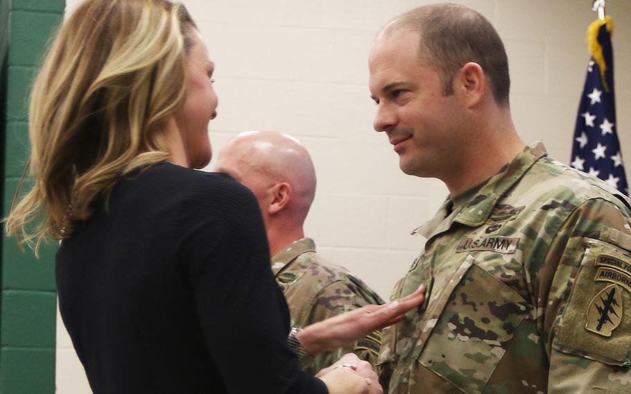 Medal of Honor recipient Matthew Williams gets promoted to sergeant major by his wife during a ceremony at Fort Bragg, N.C., on Feb. 28, 2020.