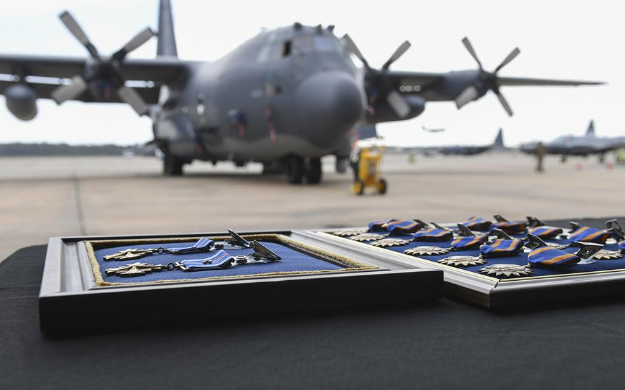 Two Distinguished Flying Crosses and 12 Air Medals lay on a table before a presentation ceremony at Hurlburt Field, Florida, Mar. 2, 2020.