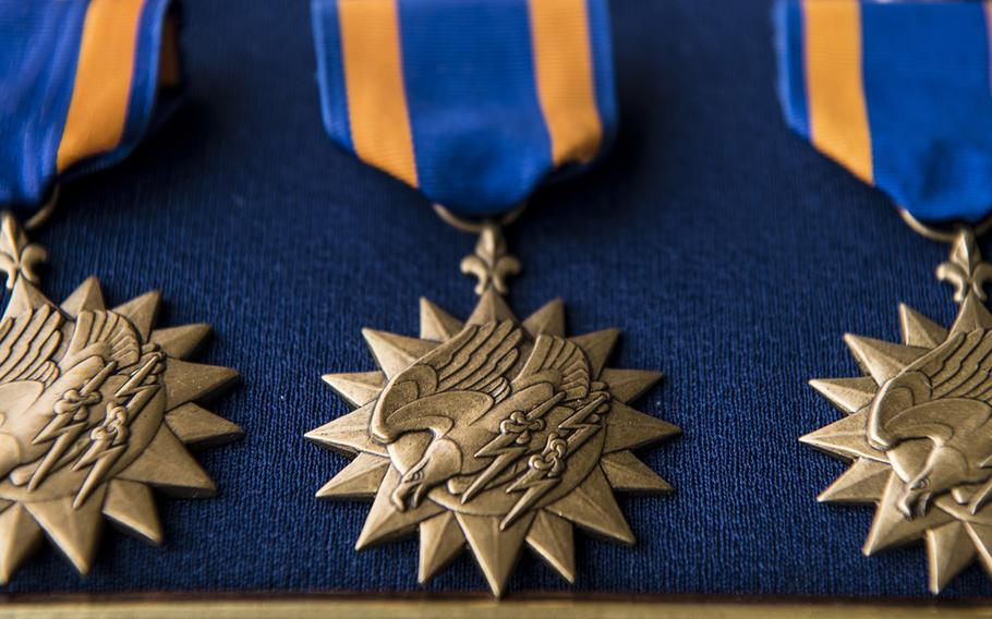 Air Medals lay on a table before a presentation ceremony at Hurlburt Field, Florida, Mar. 2, 2020.