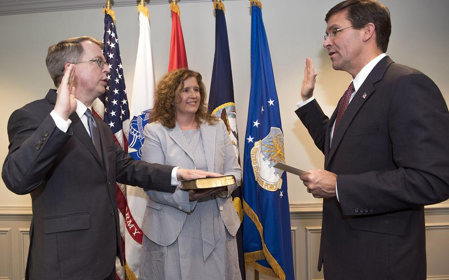 Secretary of Defense Mark T. Esper, right, swears in Deputy Secretary of Defense David L. Norquist at the Pentagon, Washington, D.C., July 31, 2019. Amid the coronavirus pandemic, contact between the two leaders will be limited to teleconferencing.