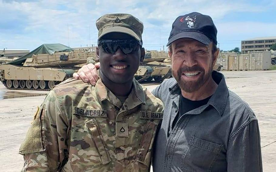 Spc. Freddy Beningo Delacruz Jr., shown here with actor Chuck Norris in a 2019 photo posted to social media, was one of three victims found shot dead in an apartment complex near Fort Hood on Saturday, March 14, 2020.