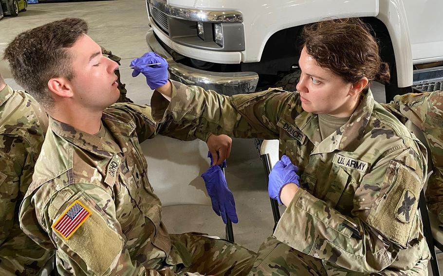 Medics with the Louisiana Army and Air National Guard conduct training with the Department of Health and Human Services to ensure proper protection and administering of drive-thru testing, March 18, 2020, in New Orleans.