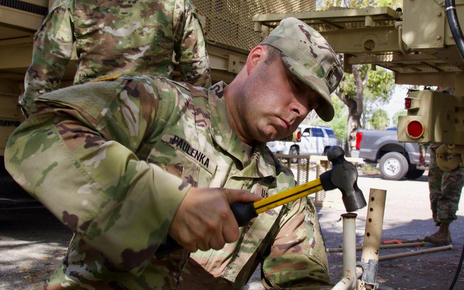 Florida National Guard Chief Warrant Officer Cliff Paulenka, with the 50th Regional Support Group, works on setting up a mobile operation center at a COVID-19 Community Based Testing Site, March 19, 2020.