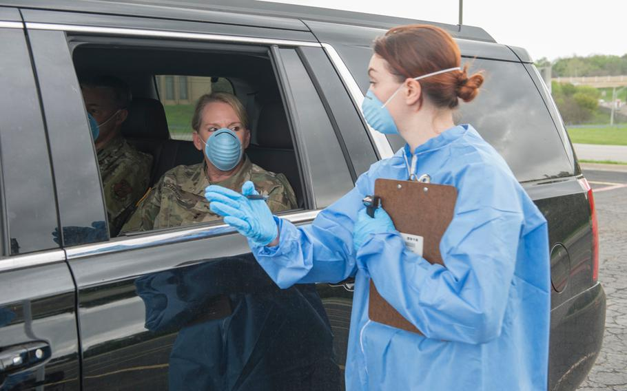 Texas Army National Guard Spc. Amanda Patton, assigned to the Medical Readiness Clinic Detachment, performs a mock drive-through COVID-19 screening with Maj. Gen. Tracy R. Norris, the adjutant general of Texas on March 18, 2020.