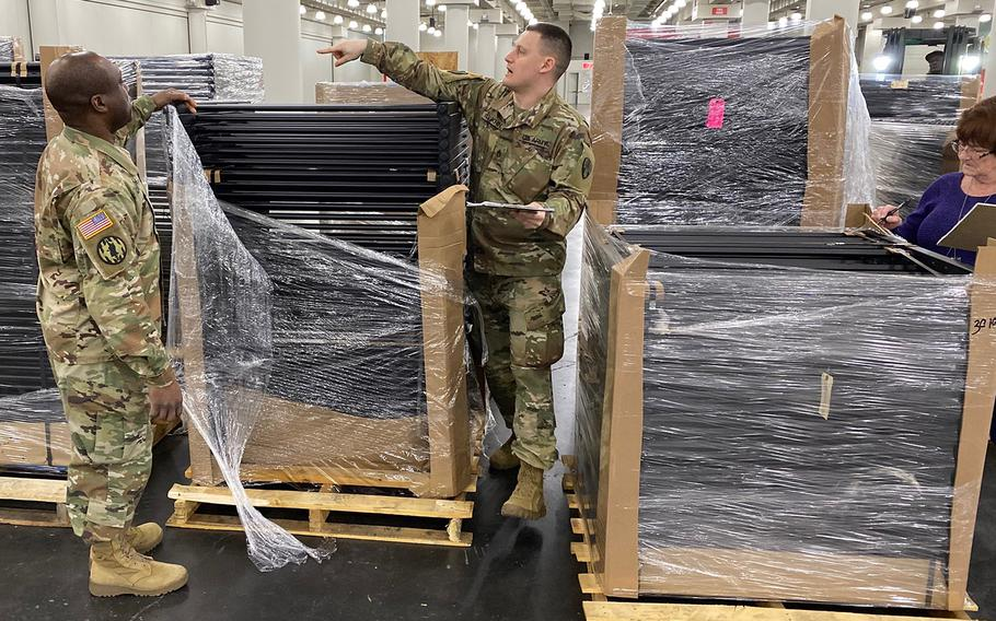 New York Army National Guard Soldiers of the 133rd Composite Supply Company, part of the 53rd Troop Command, warehouse and inventory the initial shipments of a FEMA Field Hospital for setup at the Jacob Javits Convention Center in New York City March 25, 2020.