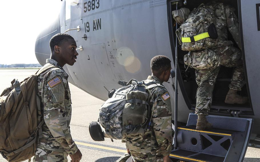 At Fort Campbell, Ky., soldiers assigned to the 531st Hospital Center and 586th Field Hospital load their gear and board a military transport aircraft headed for New York, March 25, 2020.