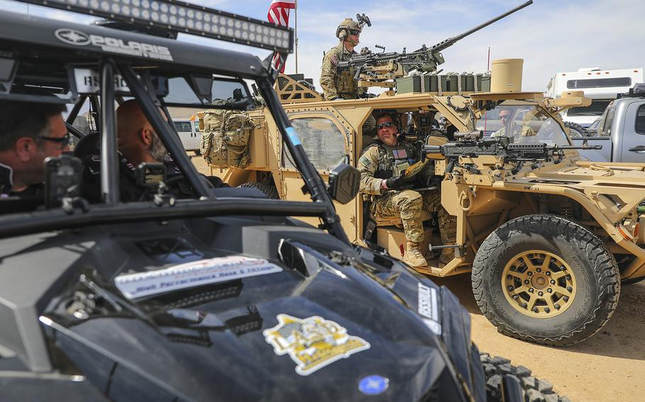 Green Berets with the 5th Special Forces Group (Airborne), converse with other racers prior to racing in the Mint 400, March 06, 2020, in Primm, Nevada.
