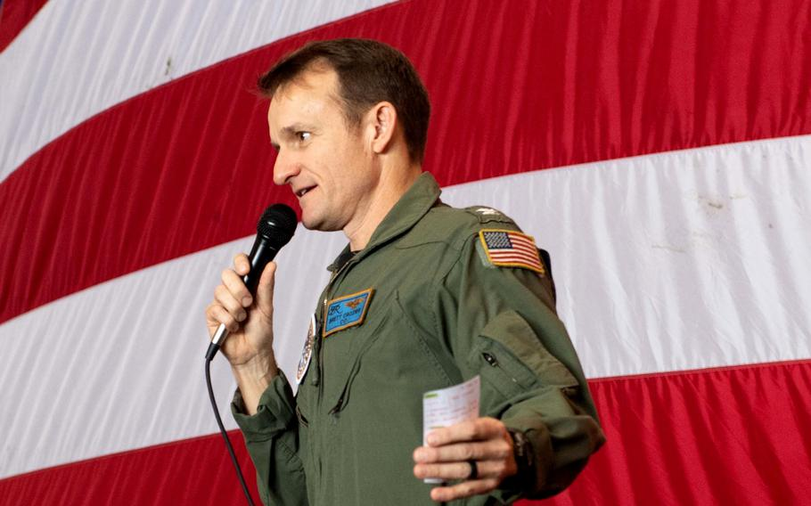 Capt. Brett Crozier, then-commanding officer of the aircraft carrier USS Theodore Roosevelt addresses the crew during an all-hands call in the ship's hangar bay March 3, 2020.  Crozier was relieved of command after his letter that warned sailors could die from the coronavirus outbreak aboard the carrier was leaked to the media.