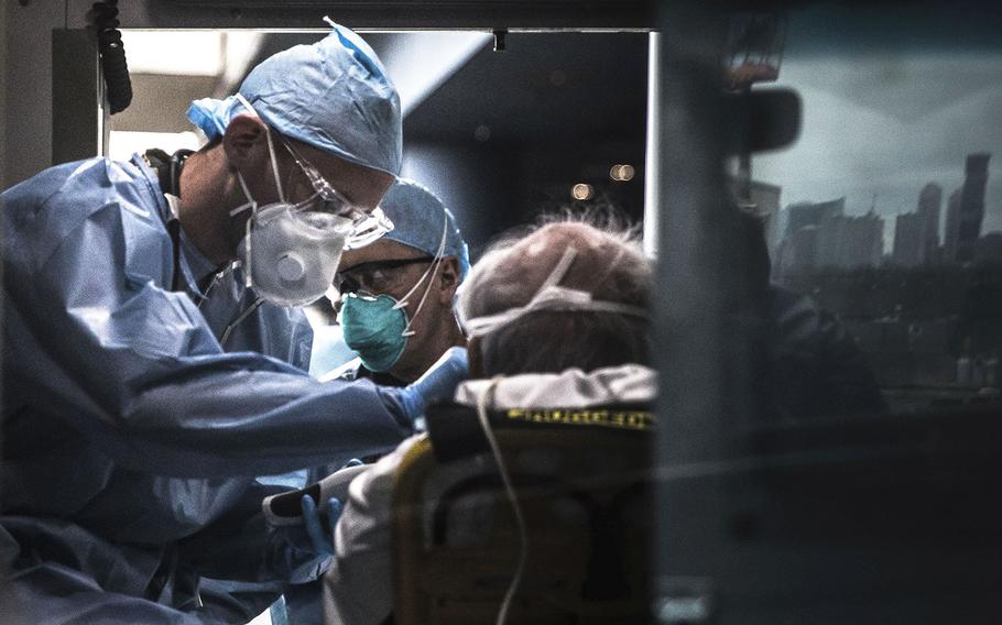 U.S. Army Spc. Daniel Fields, assigned to the 9th Hospital Center, takes a patient's vital signs inside of an ambulance at the Javits New York Medical Station on March 31, 2020.