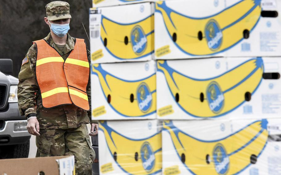 A Michigan Army National Guard soldier in Kentwood, Mich., assists Feeding American West Michigan Food Bank in distributing over 20,000 pounds of food to families in need in west Michigan as part of the Guard's coronavirus response, April 2, 2020.