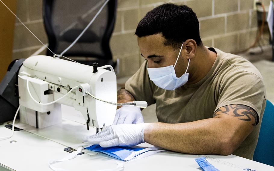 A parachute rigger with 1st Special Forces Group (Airborne), Group Support Battalion sews surgical masks for medical patients at Joint Base Lewis-McChord, Wash., on March 31, 2020.