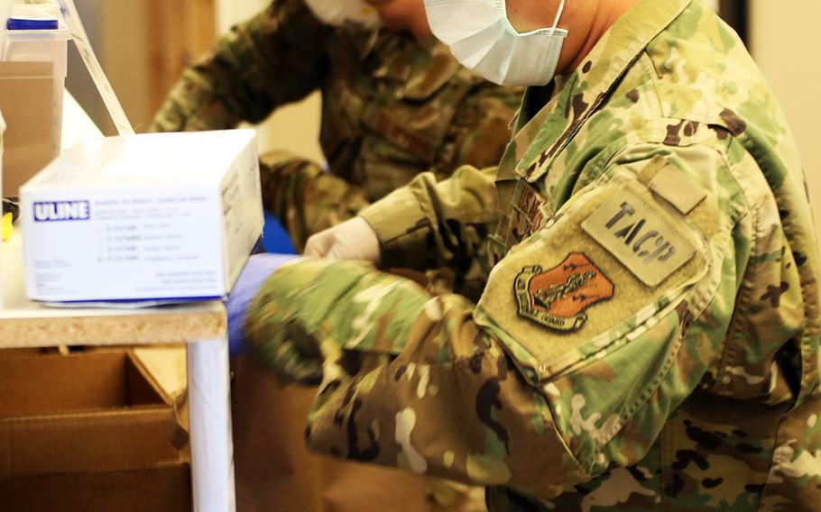 2nd Lt. Isaac Arasato of Renton, a member of the 111th Air Support Operations Squadron, prepares bags of fruit and vegetables for pickup at the Issaquah Food Bank on Tuesday, April 7, 2020, in Issaquah, Wash.  Members of the Washington Air and Army National Guard are supporting food banks around the state during the COVID-19 pandemic response.