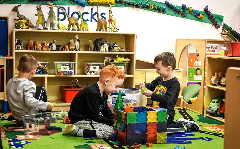 Three boys in the Strong Beginnings program at Fort Carson's Ivy Child Development Center play in the block area March 13, 2020.