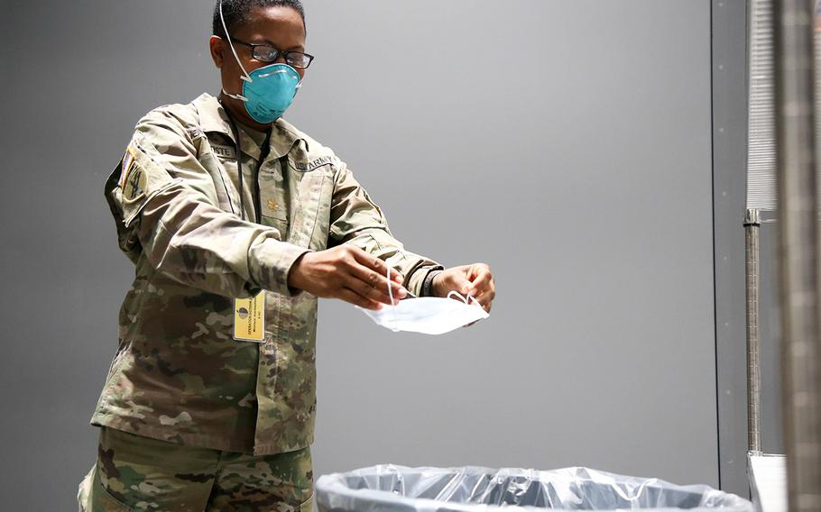 Army Maj. Monique Jeanbaptiste, with the 9th Hospital Center, removes her protective mask at the Javits New York Medical Station's doffing station, April 17, 2020.