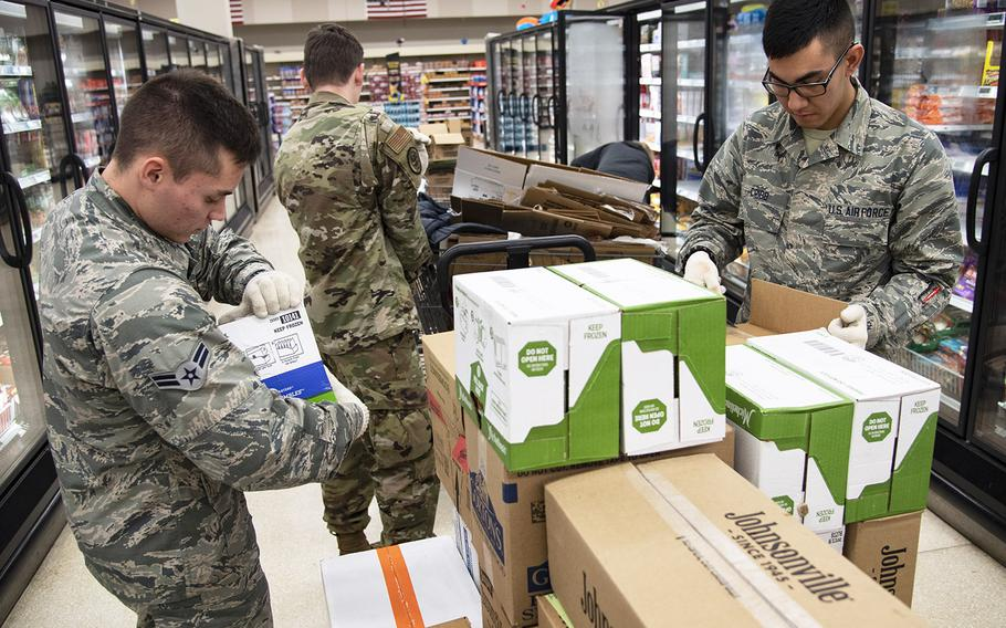 From left, Airman 1st Class Kyle Mason, Airman Bryce Jones and Airman Jackson Cribb, 362nd Training Squadron crew chief apprentice course students, help stock shelves at Sheppard Air Force Base, Texas, April 2, 2020.