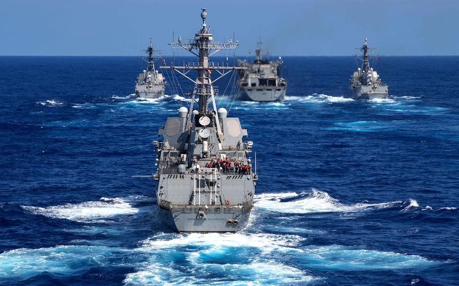 In a Sept. 7, 2019 photo, the guided-missile destroyer USS Gravely, left, the fast combat support ship USNS Supply, front center, the guided-missile destroyer USS Forrest Sherman, right, and the guided-missile destroyer USS Winston S. Churchill conduct a refueling-at-sea in the Atlantic Ocean.