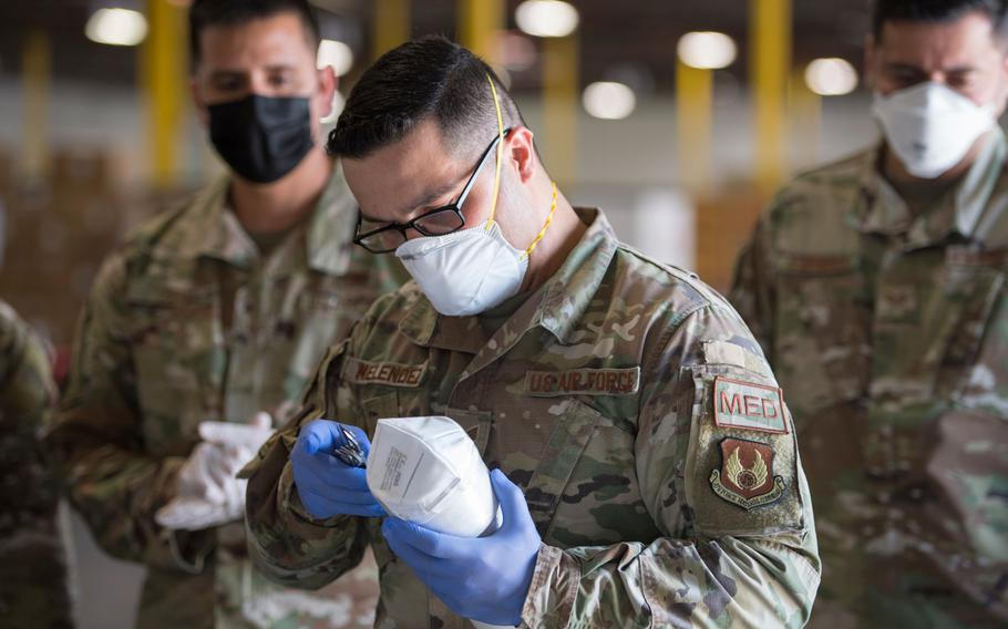 Staff Sgt. Noel Hernandez, an Air National Guard member with the 149th Fighter Wing, inspects a mask for safety compliance in response to the COVID-19 pandemic, April 24, 2020, San Antonio, Texas.