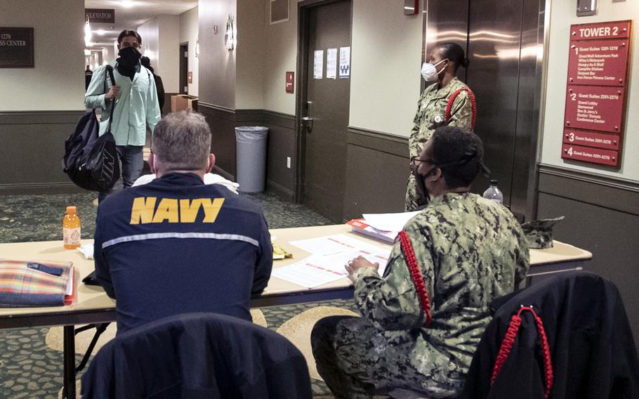 Recruit Training Command staff check in new recruits at an off-base facility for a 14-day Restriction Of Movement prior to the recruits beginning their official in-processing for basic training.
