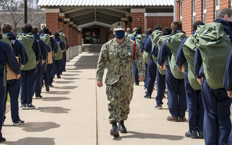 Chief Interior Communications Electrician Joseph Christensen instructs recruits as they arrive at Recruit Training Command following a 14-day Restriction of Movement period at an off-site facility.