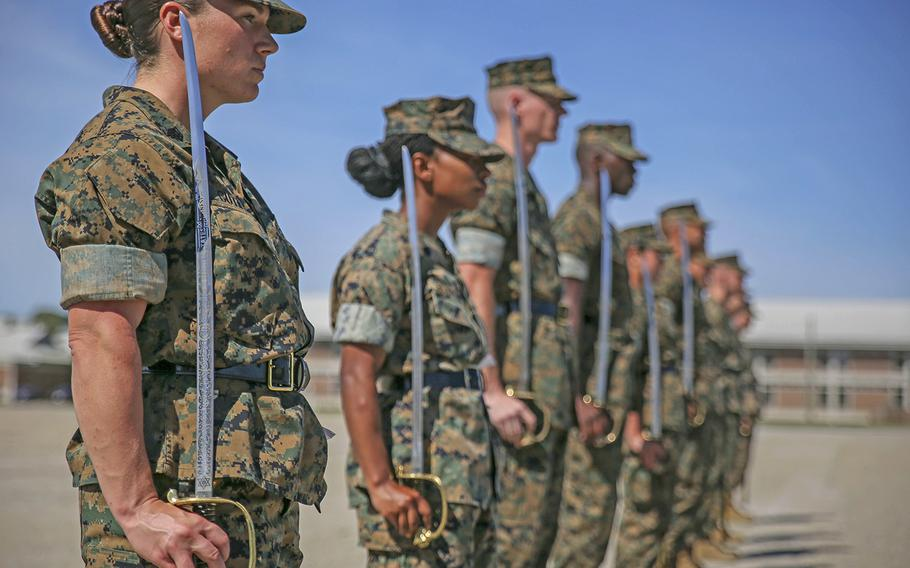 Marine instructors with Drill Instructor School aboard Marine Corps Recruit Depot Parris Island instruct and mentor Drill Instructor School candidates during close-order drill practice on Parris Island, S.C., on April 17, 2019.