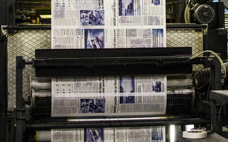 An edition of Stars and Stripes rolls through the press at a printing plant in the Middle East.