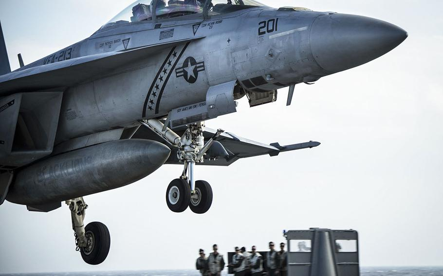 """In a January 13, 2018 photo, an F/A-18F Super Hornet assigned to the """"Black Lions"""" of Strike Fighter Squadron  (VFA) 213 prepares to land on the flight deck of USS Gerald R. Ford."""