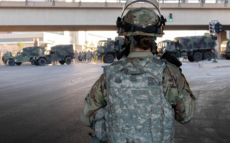 Troops from the Minnesota National Guard conduct a security mission alongside local law enforcement under State Highway 55 in Minneapolis on Friday night.