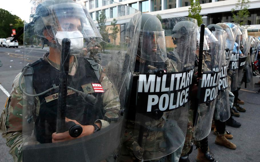 Police clear the area around Lafayette Park and the White House as demonstrators gather to protest the death of George Floyd, Monday, June 1, 2020, in Washington.