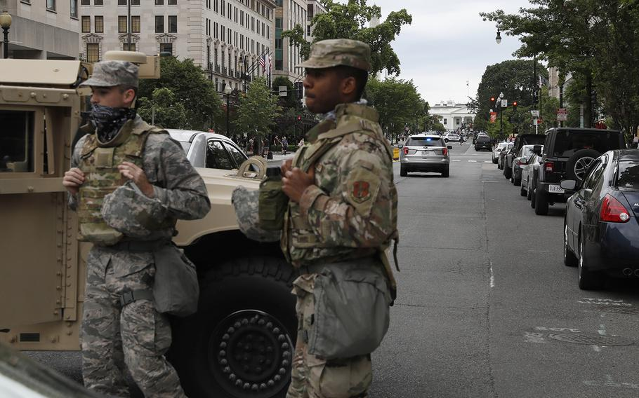 Members of the DC National Guard block an intersection on 16th Street as demonstrators gather to protest the death of George Floyd, Tuesday, June 2, 2020, near the White House in Washington.