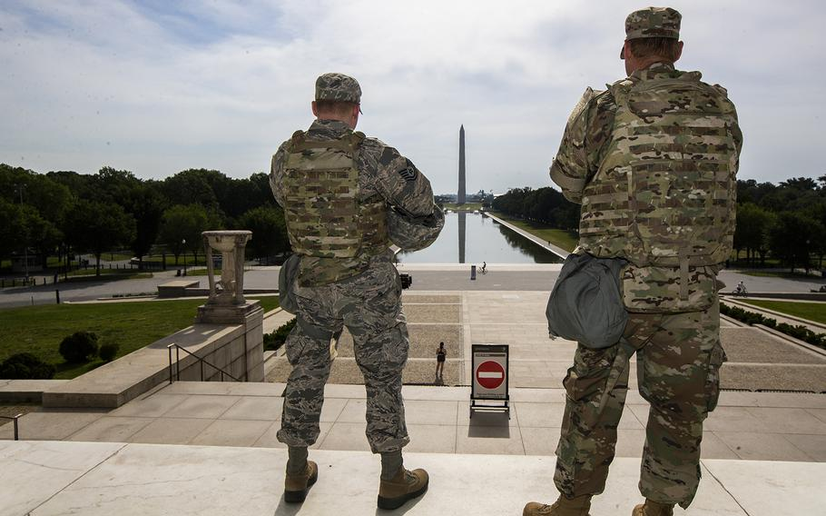 Members of the District of Columbia Army Nations Guard stand guard at the Lincoln Memorial in Washington, Wednesday, June 3, 2020, securing the area as protests continue following the death of George Floyd, a who died after being restrained by Minneapolis police officers.