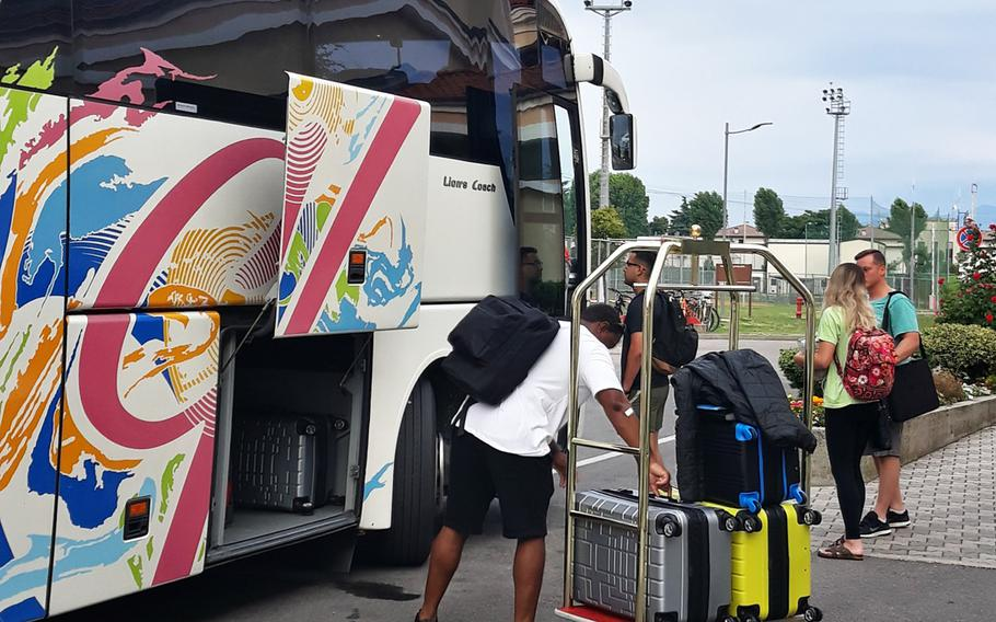 In a July, 2019 photo, soldiers and families PCS-ing from USAG Italy load their luggage onto the shuttle bus to Marco Polo International Airport.