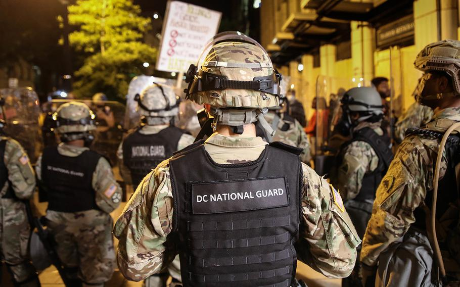 District of Columbia National Guard soldiers and airmen assist local authorities at a barricade site in Washington, D.C., on May 31, 2020.