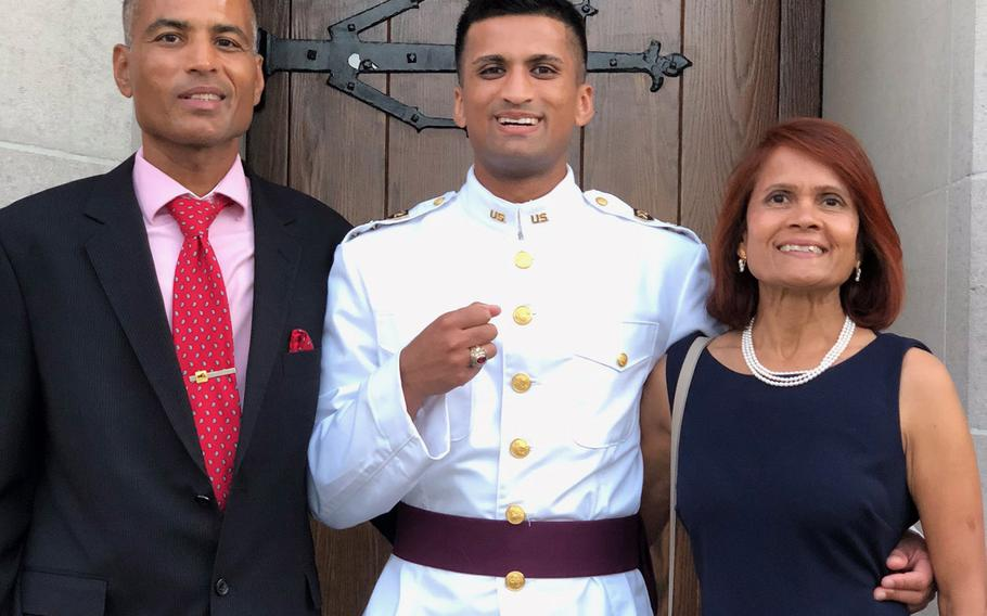 Chandra and Indu Mundra with their son Anant Mundra during a previous visit to the U.S. Military Academy at West Point, N.Y. Anant Mundra will graduate from the academy Saturday in a virtual ceremony. While his parents can't attend in person, they said they are proud and intend to watch all related events from their home in California.