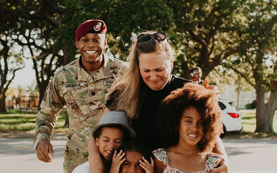 Lt. Col. Simon McKenzie gets ready to surprise his family during a photo shoot.