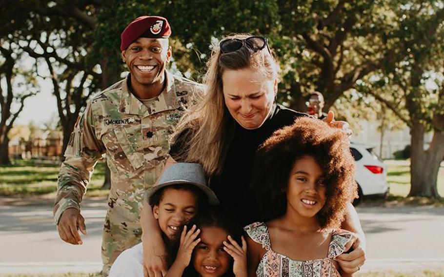 Lt. Col. Simon McKenzie prepares to reunite with his family after a deployment to Quatar.