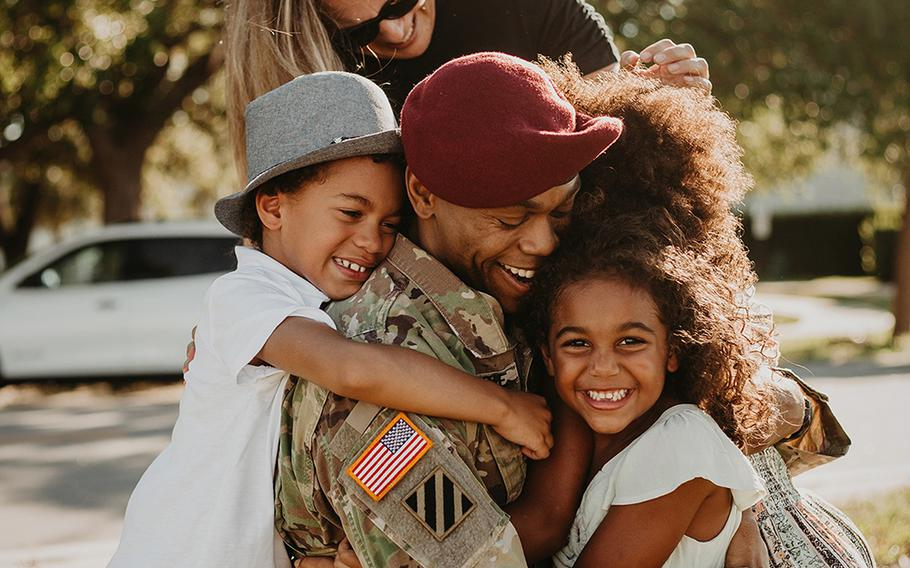 """""""Daddy! Daddy"""" yell the McKenzie kids as they reunite with Lt. Col. Simon McKenzie after his 2020 deployment to Quatar."""