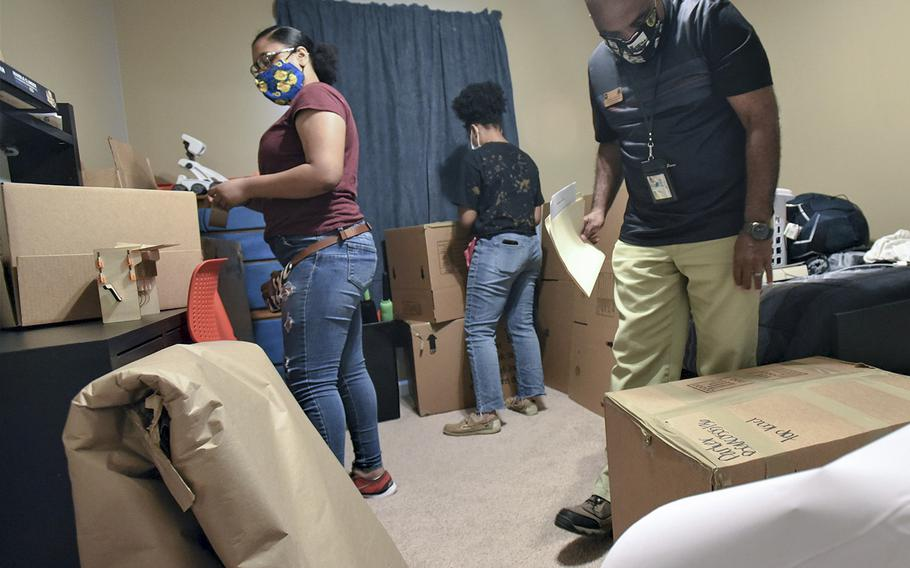 Jay Glover, right, a quality control inspector from the Fort Knox Transportation office, inspects some boxes being packed during a move-out recently. Glover said they are getting prepared for the adjusted peak PCS season, set to begin by July 1 and go into November this year.