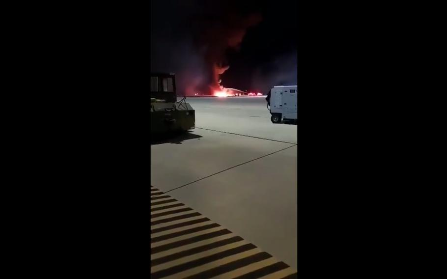 """This screenshot from a video posted to Facebook shows the Air Force F-16CM Fighting Falcon that crashed late Tuesday during """"a routine training mission"""" at Shaw Air Force Base, S.C."""