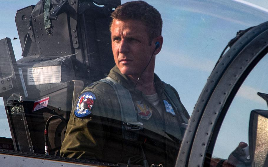 Lt. Col. Jonathan Kassebaum, 159th Fighter Squadron F-15 Eagle pilot, watches his wingmen park their planes, Aug. 30, 2019, at Wright-Patterson Air Force Base, Ohio