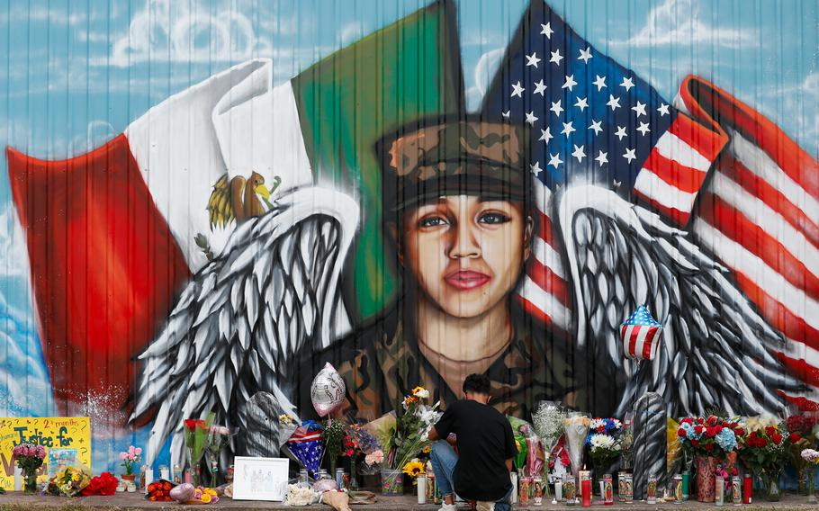 Juan Cruz, boyfriend of Army soldier Vanessa Guillen, kneels in front of a mural honoring her Sunday, July 5, 2020, in Houston.