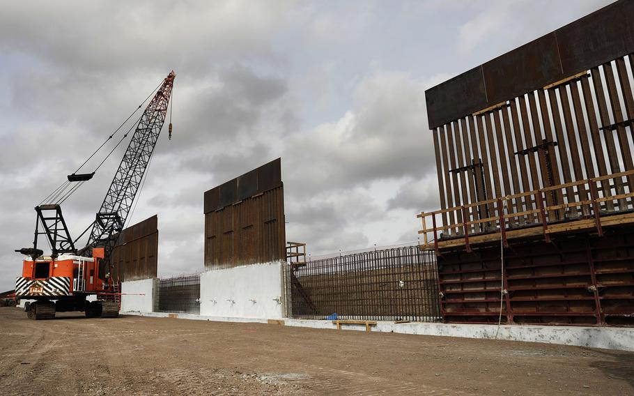 Construction crews work to erect levee wall system in a remote area south of Weslaco, Texas, in the U.S. Border Patrol's Rio Grande Valley Sector. Jan. 13, 2020.