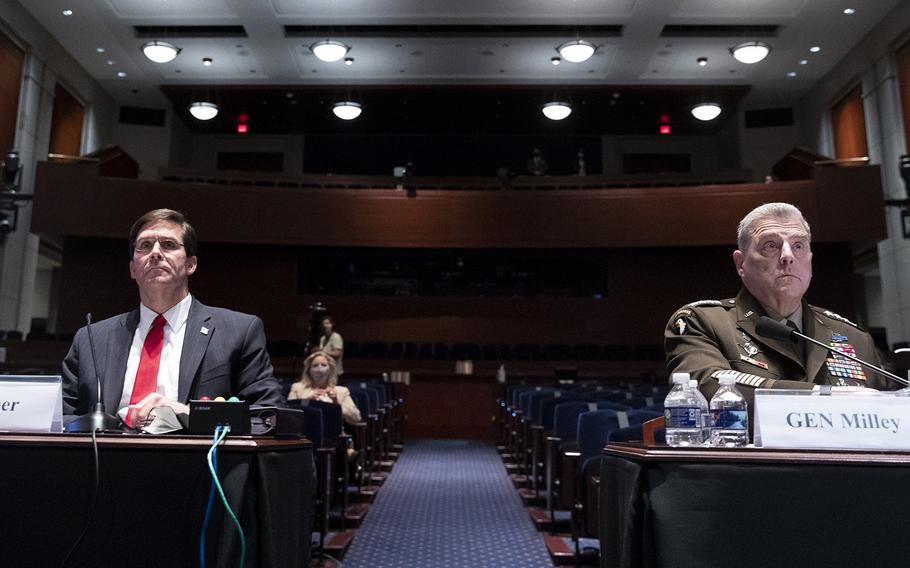 Defense Secretary Mark Esper, left, and Chairman of the Joint Chiefs of Staff Gen. Mark Milley appear during a House Armed Services Committee hearing on Thursday, July 9, 2020, on Capitol Hill in Washington.