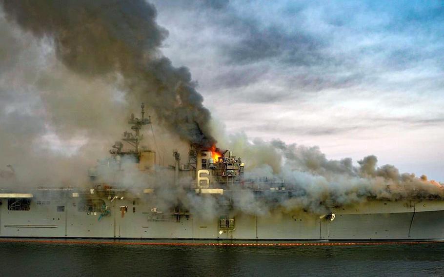 Firefighters battle a blaze on board the amphibious assault ship USS Bonhomme Richard at Naval Base San Diego, Sunday, July 12, 2020.
