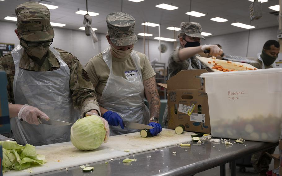 Arizona National Guard service members help prepare meals July 6, 2020 at Saint Vincent de Paul's rescue mission in Phoenix for local homeless. The assistance is part of the Arizona National Guard's multifaceted response to community needs during this COVID19 state of emergency.